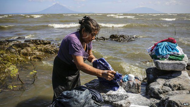A woman washes clothes on the shore of Cocibolca Lake in Rivas, Nicaragua on 11 December, 2014