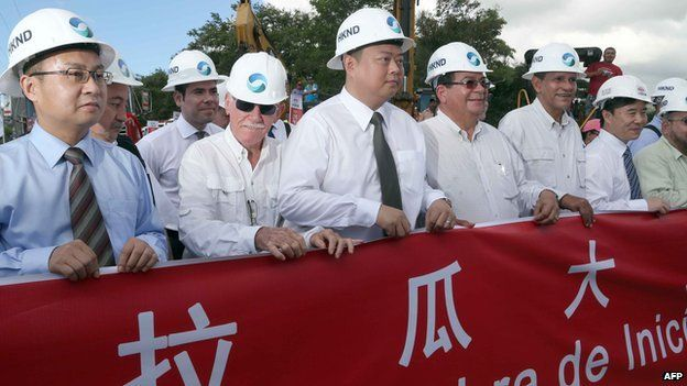 Chinese businessman Wang Jing (C) of HKND Group, members of the Nicaraguan government and members of the Commission of the Grand Inter-Oceanic Canal attend the inauguration of the works in Tola, some 3 km from Rivas, Nicaragua, on 22 December, 2014
