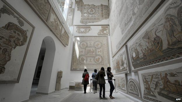 Tourists watch mosaics at Bardo museum in Tunis, 17 May 2012