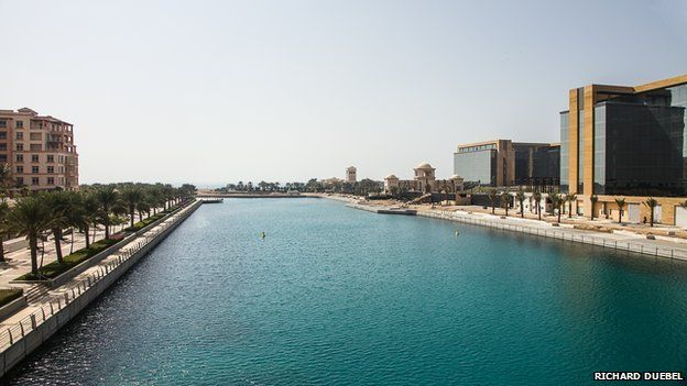 View of a canal surrounded by buildings