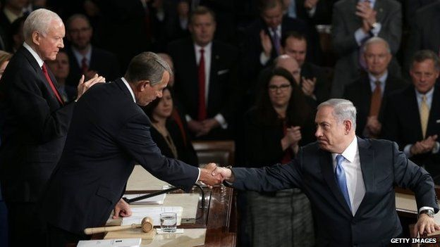 Israeli Prime Minister Benjamin Netanyahu (right) shakes hands with U.S. Speaker of the House John Boehner (left) after addressing a joint meeting of the United States Congress in the House chamber at the U.S. Capitol 3 March