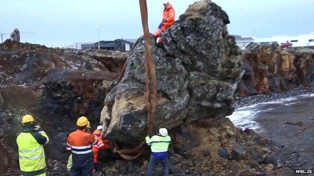 A crane is used to move a rock in Iceland thought to be an elf church to make way for a new road on 18 March 2015
