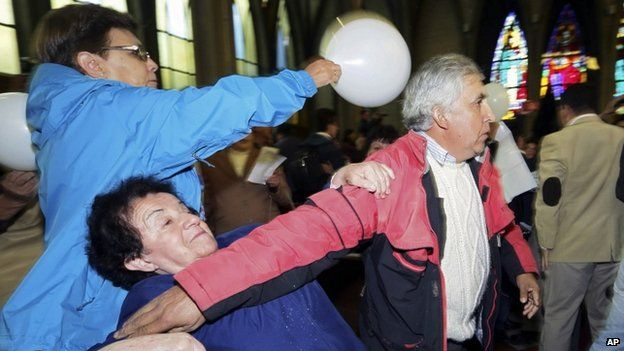 Supporters of Bishop Barros tried to stop the protest