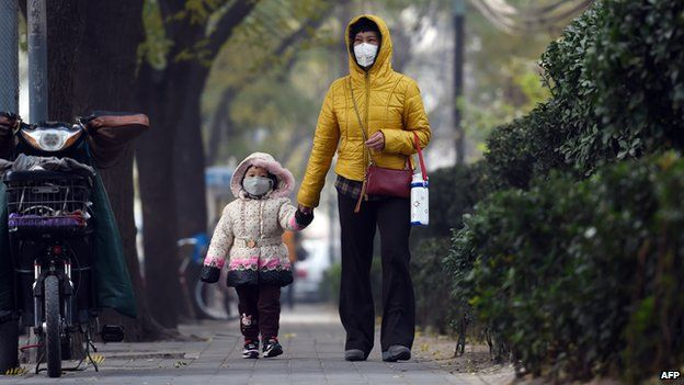China woman and child, walking with face masks