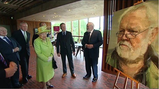 The Queen and Irish President Michael D Higgins speaking to Michael Longley at Belfast's Lyric Theatre in 2012