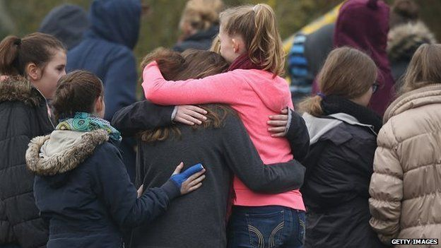 HALTERN, GERMANY - 25 MARCH: Pupils gather at the Joseph-Koenig-Gymnasium high school to pay tribute to 16 students and two teachers from the school who were on Germanwings flight 4U9525