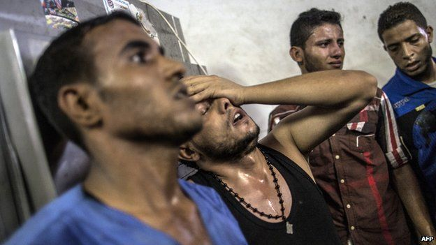 Relatives mourn Palestinian children killed by explosion in Shati refugee camp, Gaza, on 28 July 2014