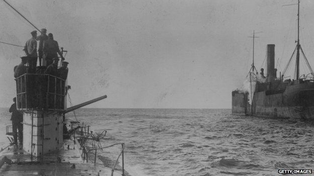 A U-boat opens fire with a deck cannon, upon an allied merchant ship