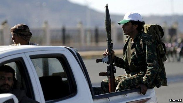 Houthi fighters ride a patrol truck in Sanaa March 25, 2015