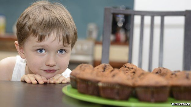 Child eyeing up cake