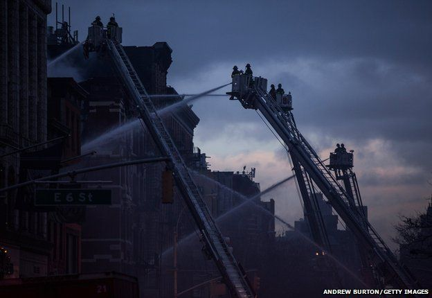 Firefighters battle a blaze caused by an explosion