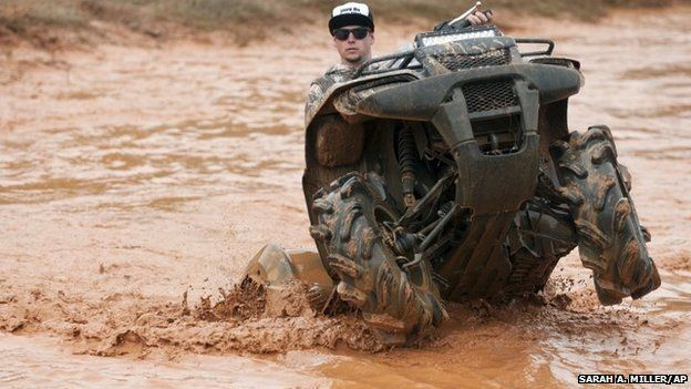 Will Caraway rides through a mud pit