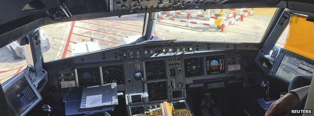 A pilot stands inside the cockpit during boarding for the Germanwings flight 4U9441, formerly flight 4U9525