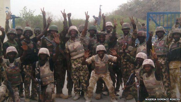 Nigerian soldiers celebrating their capture of Gwoza in Nigeria