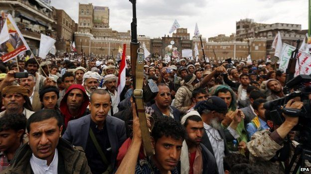 Armed Houthi members hold their guns in the air while shouting anti-Saudi slogans during a rally protesting Saudi-led airstrikes against Houthi positions in Sanaa, Yemen, 26 March 2015