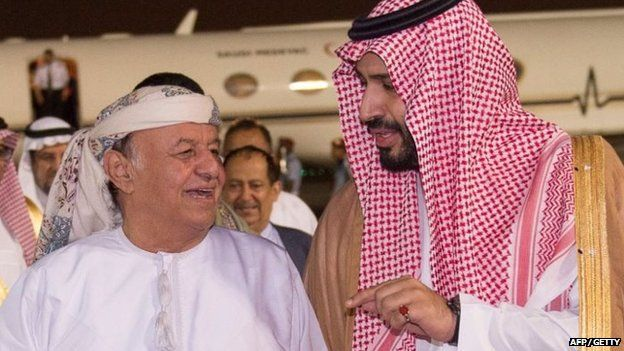 A handout picture provided by the Saudi Press Agency (SPA) on 26 March 2015 shows Saudi Defence Minister Prince Mohammed bin Salman (R) receiving Yemeni President Abdrabbuh Mansour Hadi upon his arrival at an airbase in the Saudi capital Riyadh