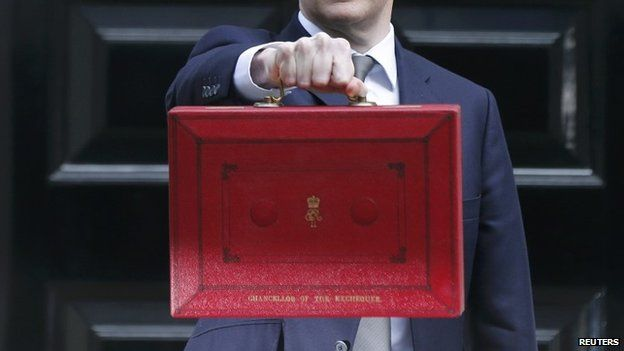 George Osborne holds up Budget case as he stands outside Number 11 Downing Street