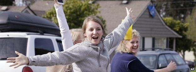 Supporters of Amanda Knox leave her mother's home looking happy