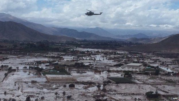 Handout picture released by the Chilean air force of a military helicopter overflying Chanaral on 26 March, 2015