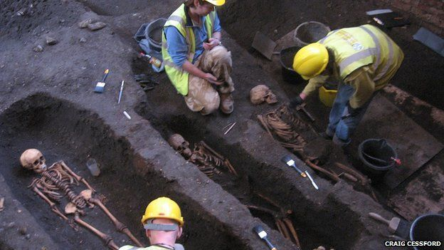 Archaeologists uncovering bodies at St John's College