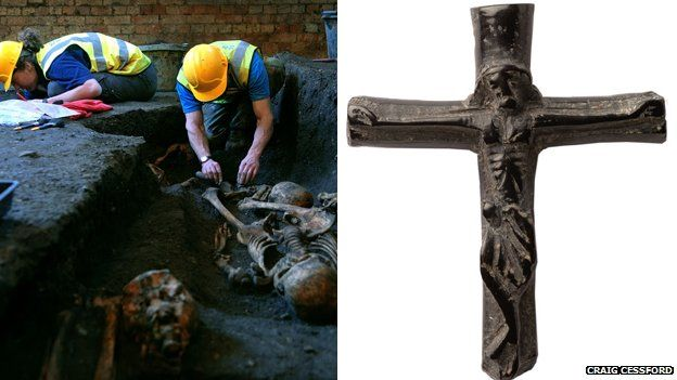 Archaeologists uncovering bodies at St John's College and a crucifix