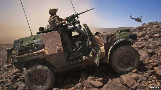 A French soldier stands guard in an armoured vehicle in northern Mali in March 2013.