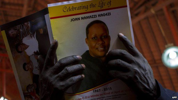 A man holds a programme during the church service for late acting assistant director of public prosecution Joan Kagezi on April 2, 2015 in Kampala