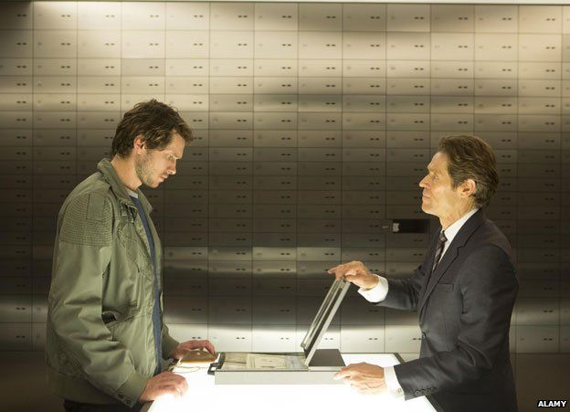 Grigory Dobrygin and Willem Dafoe in the bank vault in A Most Wanted Man