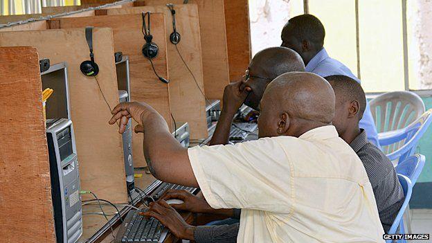 Men in an internet cafe in Kinshasa