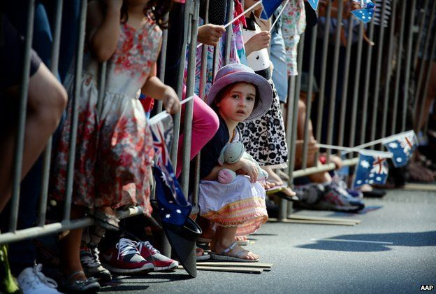 Children watch the Anzac Day parade in Brisbane, Friday, 25 April 2014.