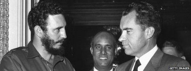 Cuban President Fidel Castro shakes hands with US Vice-President Richard Nixon during a press reception in Washington in 1959