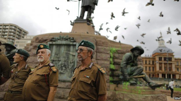Afrikaner members of the Boere Kommando stand at the base of the memorial for Afrikaner hero Paul Kruger in central Pretoria, South Africa, 8 April 2015