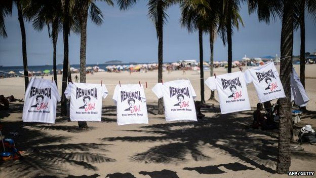 "T-shirts reading ""Resign now! for the sake of Brazil"" during a protest against the government of Brazilian President Dilma Rousseff at Copacabana beach in Rio de Janeiro, Brazil on 12 April 2015."