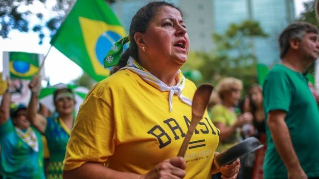A woman bangs a pan during a protest against Brazilian President Dilma Rousseff in Porto Alegre, Brazil on 12 April 2015.