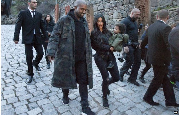 Kanye West with Kim Kardashian and daughter