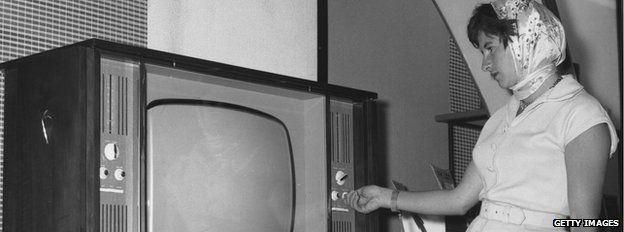 woman looks at TV, 1960