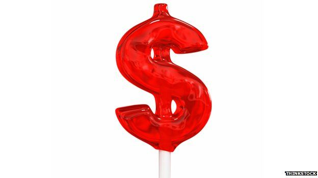 A lolly pop in the shape of a dollar sign