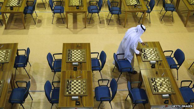 A match referee make sure chess boards are set correctly prior to the FIDE World Rapid & Blitz Chess Championships 2014 in Dubai (19 June 2014)