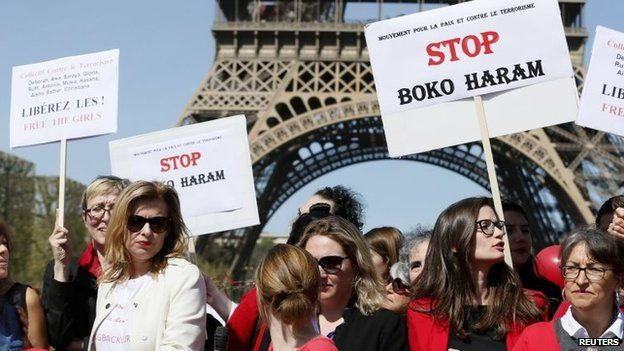 """Former French first lady Valerie Trierweiler (L) attends a """"Bring Back Our Girls"""" gathering near the Eiffel Tower in Paris, 14 April 2015"""