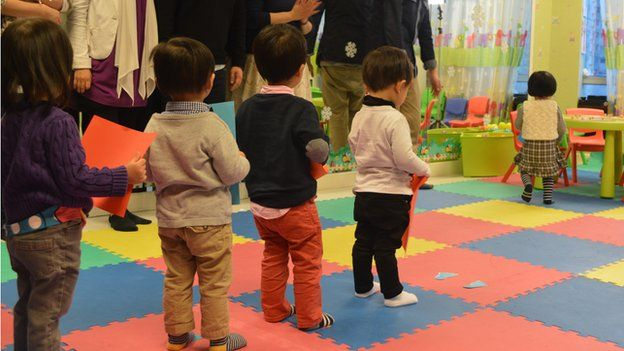 Children queue during a session at HKYTA, 25 February 2015