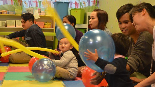 Children and parents play with balloons at an HKYTA session