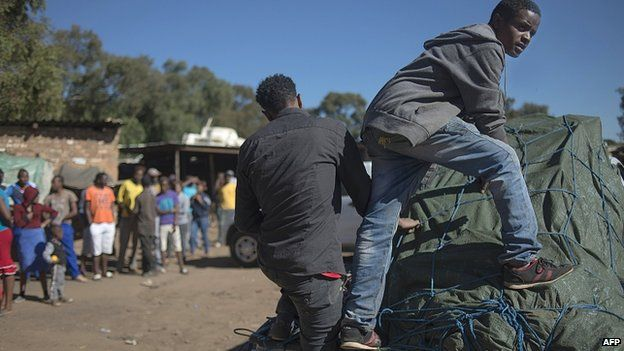 Foreign nationals pack up their shops in the small village of Primrose, near Germiston about 15kms east of Johannesburg, on 16 April 2015