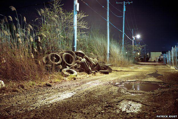scrapyard by night