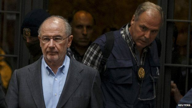 Rodrigo Rato is escorted from his home by investigators, Madrid, 16 April 2015