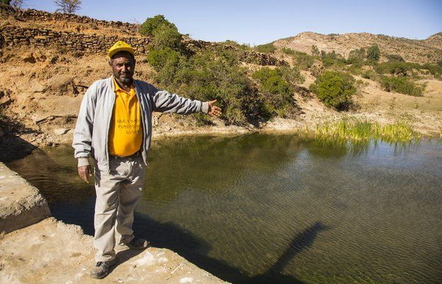 Village chief and head motivator Aba Hawi shows off one of the 18 dams built by communal labour on what was once a flash-flood gully.