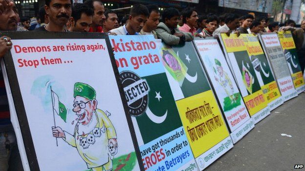 Bangladesh Awami League supporters protest with anti-Pakistan placards in Dhaka on December 23, 2013