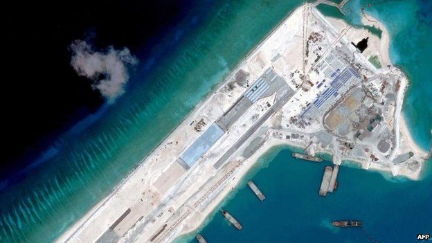 This handout photo taken on April 2, 2015 by satellite imagery provider DigitalGlobe shows a satellite image of what is claimed to be an under-construction airstrip at Fiery Cross Reef