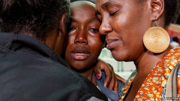 People react after meeting their relative who was rescued from the Garissa University