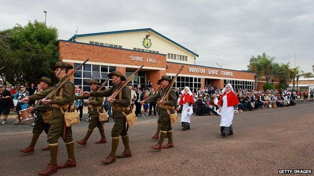 """Members of the """"9th Battalion AIF Living History Unit"""" march in Winton, Australia."""
