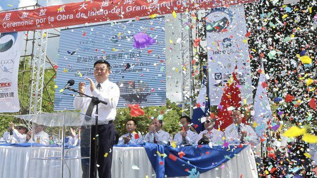Chinese businessman Wang Jing of HKND Group applauds next to members of the Nicaraguan government during the inauguration of the works of an inter-oceanic canal in Tola, some 3 km from Rivas, Nicaragua, on December 22, 2014